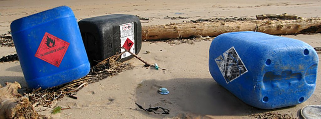 BS5609 labels on chemical drums on beach